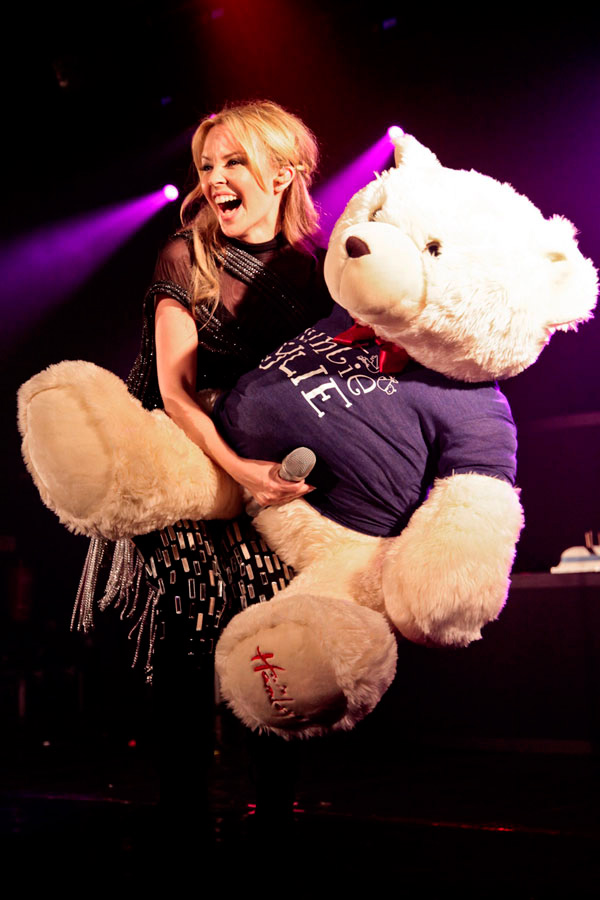 Kylie holding a giant bear in what looks like a rather compromising position