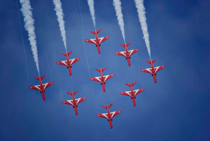 The famous Royal Air Force Red Arrows flying in Diamond Nine Formation